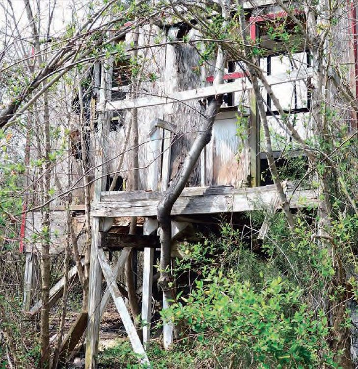 The timing tower is barely standing on its own, and almost all of the siding has been ripped off during the track's abandonment. The area behind the tower is impassible due to the overgrowth, but many areas of the track are clear enough to do some exploring, especially in winter.