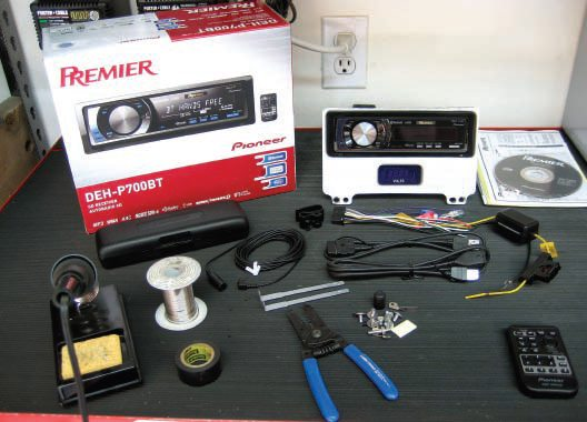 This is the complete kit from Pioneer. As you can see, I've already taken care of the physical mounting of the radio as it is mounted in the custom 3/8-inch billet aluminum panel that is shaped identical to the stock radio. Below the radio is a Dakota Digital Volt Meter that allows me to keep tabs on the voltage at my amplifiers directly.