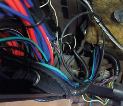 Note the new Green and Blue wiring routed neatly along an existing harness going up and over the steering column on its way to the driver-side kick panel.