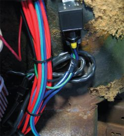 Note the Green and Blue wiring tied neatly to an existing harness as it makes its way to the passenger-side kick panel.