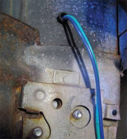 This is an interior shot of the passenger door. Note that the wiring comes through the snap bushing, and it is anchored to the door itself.