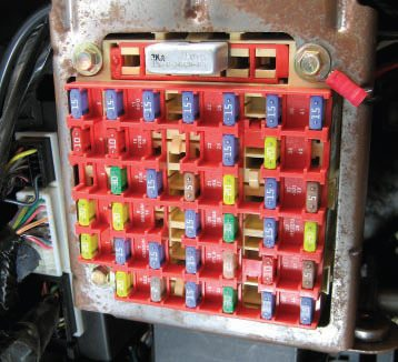 The Mustang's interior fuse panel is located under the dash and to the left of the steering column. To the left of the fuse box is the G.E.M. module that I refer to later in the book.