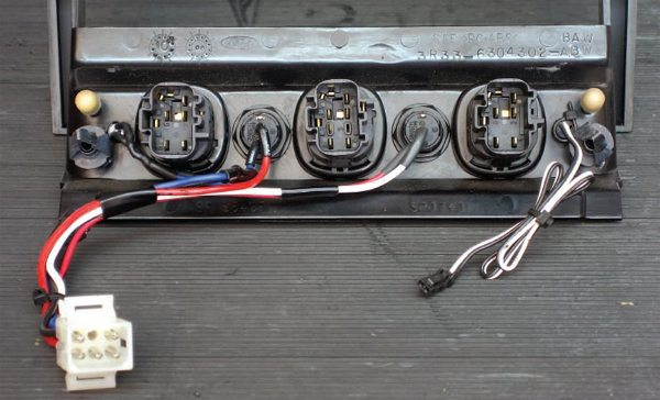 The connector for the valet switch for my security system is on the right and it is pre-terminated with a small plug—how handy that it came terminated this way. Notice how the Radio Shack six-pin connector makes the pair of switches and LED a snap to disconnect should this panel need be removed for any reason.