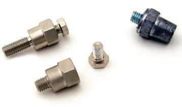 Connecting an accessory power cable to a side-post battery has never been easier. The adapter on the bottom is a standard GM side post battery adapter. On the top left is a long version of the same adapter—handy for GM trucks with diesel engines and dual batteries. On the right is an adapter designed to screw into the side post of the battery directly and allow one to use a standard top-mount battery clamp. These are available in both (+) and (-) versions as the post diameters are different.