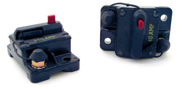 "The aftermarket has used manual- resetting circuit breakers for a long time because of their current carrying ability. Shown are a pair of 140-amp breakers that have a built in ""valet"" mode. Pressing the red button opens the breaker's arm, thereby disconnecting power to the load."