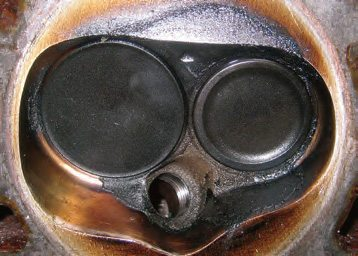 This is a head chamber from a Ford 289 Falcon vintage racer. You can see the chamber wash from wet flow. Fixes lie in many areas including booster selection, manifold finish, and general port shaping.