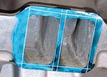 The lines are then transferred to the manifold face as seen here. I cut the sides and bottom of this tunnel ram intake to within about 0.015 to 0.020 inch of the layout lines. The top lines have not been cut yet. The remaining amount required to be cut to align the top of the port is about typical for a big-port Chevy small-block.