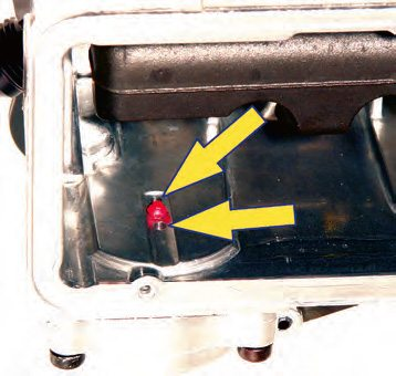 One, two, or four holes in this location allow the fuel to be drawn into the pump to replenish it after it has been actuated by the opening throttle.