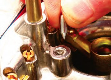 """A check valve that's a weighted conical-tipped needle below the squirters counters the effects of high-speed """"pull-over."""""""