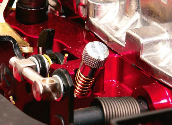 The primary idle speed adjustment screw is common to virtually all carb models.