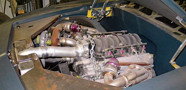 This 1969 Camaro is also outfitted with twin turbos. Quite often, because of underhood space limitations, exhaust headers are either fabricated or turned upside down (shown) in order to accommodate the turbochargers. The wastegates are installed between each header and its turbo.