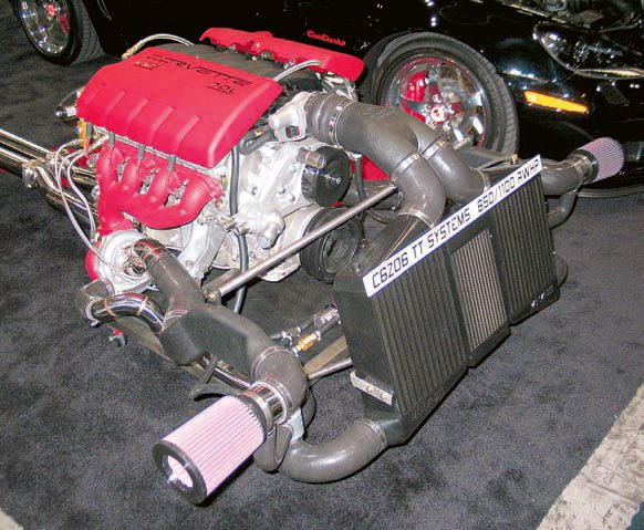 This is an example of a twin-turbo system fitted to an LS7 engine, which increases rear-wheel horsepower to 1,000 under full boost. Given the installed locations of the turbochargers, custom-formed exhaust pipes are required to route exhaust from the turbos to the remainder of the exhaust system.