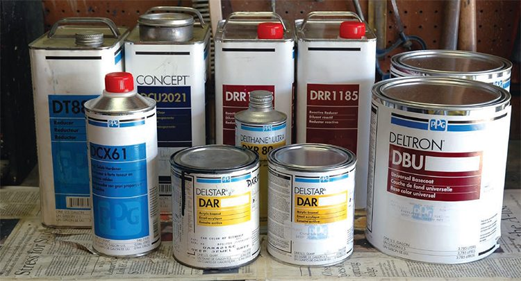 """I swore I wouldn't bore you with a bunch of paint cans, but it's inevitable in this chapter. This grouping represents just the color and clear, with attendant reducers and catalysts, for the paint on one car. It doesn't include any primers, sealers, cleaners, or other """"prep"""" products. These happen to be all PPG (formerly Ditzler) brand, purchased at the same place at the same time. The color, mixed at the paint store, is a Lincoln Mark VIII dark green metallic with pearl for my '52 Chevy, which was dark green metallic originally. This is a 2-stage system, with base coat (DBU) and clear coat (2021). While most normal-size vehicles won't require more than a gallon of mixed color, or clear, I ordered 1-1/2 gallons of color (to have plenty for dash, window frames, under hood, etc.) in two gallon cans, so I can mix the two back and forth to make sure all the color is the same before painting. The two quarts (DAR) are the same color mixed in a single-stage, which dries very glossy, for use in areas (firewall, under trunk, etc.) where I don't need the extra work of 2-stage or rub out. The only problem with buying all these products now is that the bodywork/prep on the car has taken longer than expected, and the reducer/catalyst (DRR— """"RR"""" stands for """"reactive reducer"""") """"goes bad"""" after time. Hopefully it is okay stored in a cool place, unopened."""