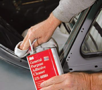 Another too-little-known product that should be in every garage is 3M Adhesive Cleaner. Made specifically to clean off excess 3M Weatherstrip Adhesive glue (it's about the only thing that will), it is also excellent for cleaning adhesive residue from masking tape left on too long (as shown here), or anything else. Once you use it, you'll wonder how you ever did without it.