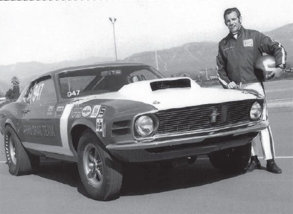 Hubert poses proudly with his eastern Ford Drag Team match racer. The '69 Mustangs received 1970 sheet metal when the new year rolled around. Hubert headed the East Coast drag team while Ed Terry spearheaded the West Coast team. There were six cars in total: The eastern cars were blue with white accents and the West Coast cars were the opposite, white with blue accents. (Photo Courtesy Jerry Heasley)