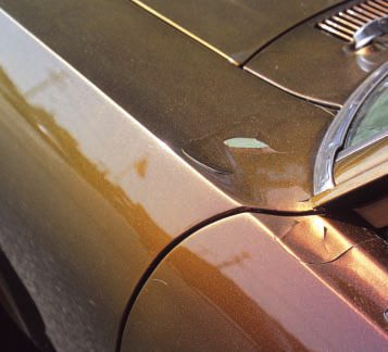 """In the prior examples the existing or underlying paint was unstable. In this case a painter for a local bodyshop added a smooth, glossy—and very expen-sive—coat of """"flip-flop"""" custom paint to his otherwise original Nova. There was nothing wrong with the existing pea green factory paint (except the color), but he failed to sand it sufficiently or use any primer or sealer to make the new paint stick, with apparent results. Given that it's already peeling, you could probably remove the top layer only, using liquid stripper."""