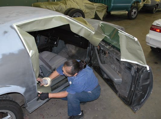"""Steve removed the door panels (mainly to get the side mirrors off). Since this was to be a """"doors closed"""" paint job, we figured that'd be it. But, again surprisingly, Alisa masked off both the doorjambs and the inside of the doors, all around."""