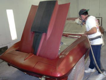 "Since the surface was all painted to start with, John didn't need an etching primer or a sealer, as such, but he wisely decided to start with a clear DuPont product appropriately called ""Mid-Coat Adhesion Promoter."" He started by spraying a thin layer inside the engine compartment and doorjambs."