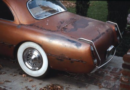 """Here's an interesting case. This shoebox Ford was a famous custom, first built in a simpler, red form by well-known Valley Custom in the early '50s, then rebuilt by them in this version later in the decade. It hasn't been touched since, but has been left outside and surface rust is forming. Should a restorer try to """"save"""" as much as possible, as is, or disassemble and strip the car to bare metal for full restoration? This surface rust looks pretty serious, and I think the latter is probably necessary (if it ever gets restored)."""