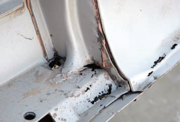 While other media are easier on sheetmetal (even aluminum or fiberglass, in some cases), a good sandblaster can remove rust, along with the paint, as shown in the tailgate corner of this '59 El Camino...