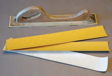 "Buy strips of 36, 80, and 180 grit paper made to fit the ""longboard"" or ""filler board.""  Cut them to fit shorter blocks. Most bodywork sanding is done with 36 grit. Use 80 grit on high-fill primers and spot putty. The 180 and finer-grit papers are covered under prepping and block sanding in Chapter 6."