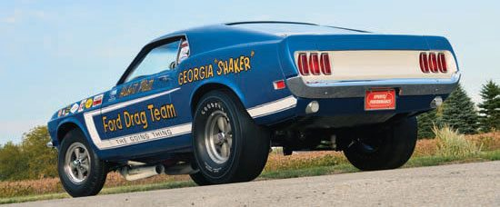 Goodyear 12 x 15 Blue Streak slicks in conjunction with Holman-Moody & Stroppe ladder bars helped get the power to the ground. Rear springs are heavy-duty Ford. Paint is pearl white and blue matched to Gordon Smith's original. (Photo Courtesy Jeff Heasley)