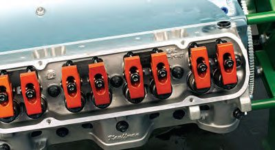Bridged roller rockers (as on this Pontiac 455, equipped with Harland Sharp rockers) feature each adjacent pair of rockers pivoting on a common shaft. This keeps each pair of rockers in alignment, preventing them from moving out of plane relative to the valves and pushrods.