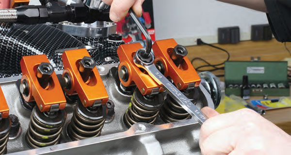 The rocker arm lock nut is properly tightened down and then valve lash will be measured.
