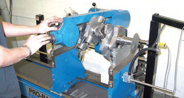 This Pro-Bal balancer features an overhead belt drive that contacts the crank's center main journal from above.