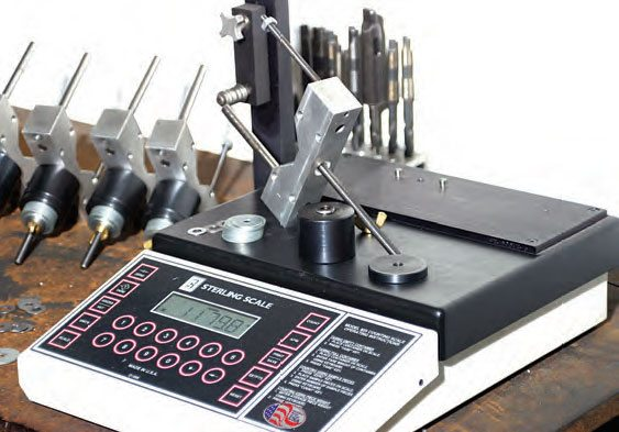 During makeup of the bobweights, they're weighed on the digital scale and adjusted (with more or fewer weights to match the required weight).
