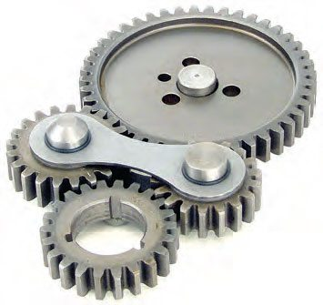 Gear drive with two idler gears. Gear drives offer accurate cam timing/drive, but can transfer more crank harmonics. Noisy and quiet versions are available. The noisy versions produce a gear-to-gear sound similar to a blower whine. This noise is matter of personal preference. (Photo Courtesy Comp Cams)
