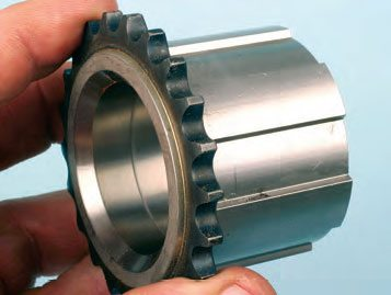 The pump's driven gear slips over and engages the drive gear, which installs onto the crankshaft snout. This OEM-LS drive gear has an integrated timing chain gear.