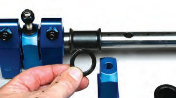 Spacer shims are placed between rockerto-stand locations and between rockerto-barrel spacers. Barrel-type spacers provide spacing between rockers.