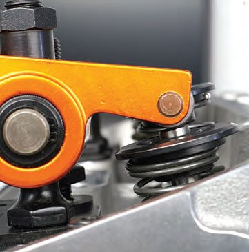 Watch the rocker-to-valve contact path as you rotate the camshaft through its complete lift cycle.
