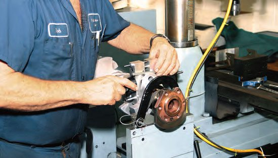 Bobweights should be centered at the width of each rod journal. To save measuring time, machinists often insert an aluminum spacer of a specific thickness to avoid the time required for measuring to center the bobweight.