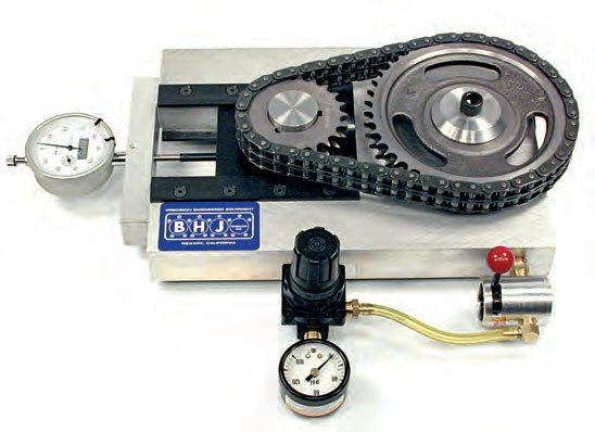 Once the engine's precise center-to-center distance is set, the timing system is placed in position with the dial indicator zeroed. Compressed air at 100 psi is applied, and the dial indicator is watched for +/–. Shown here is a chain drive check. (Photo Courtesy BHJ Products)