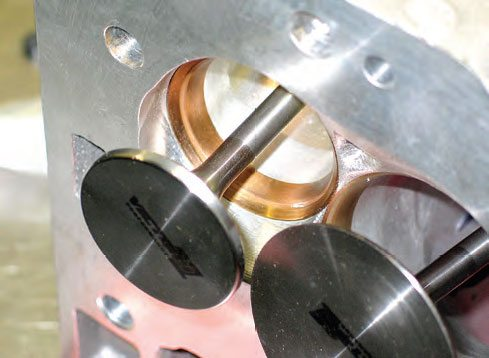 Valve seats for today's aluminum performance heads are, depending on the application, made of ductile iron, silica-bronze, beryllium-copper, powdered metal, or tungsten-carbide. These are silica-bronze seats installed in a Trick Flow cylinder head. Seat material must be compatible with the type of valve material being used.