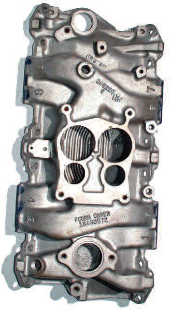 This typical, stock two-plane intake for a small-block Chevy utilizes a Quadra Jet carb. These feature small primary barrels and large secondaries. Because little attention was paid to port routing, the airflow on these intakes is very poor.