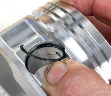 """Spiral locks can be tricky at first, but once you install a few it becomes second nature. After gently spreading the spiral apart, insert one end and """"walk"""" the remainder in a counterclockwise direction into the groove until the final end snaps into place. Some installers use their fingers along with a small, flat-blade screwdriver, but specialty installer tools are available."""