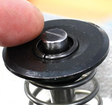 Mark the valve stem tip with a marker. With the pushrod and rocker arm in place, roll the cam through a full cycle. Remove the rocker arm and check the witness mark that indicates tip travel. The width of the mark should be .080 inch or less. (Photo Courtesy Trick Flow Specialties)