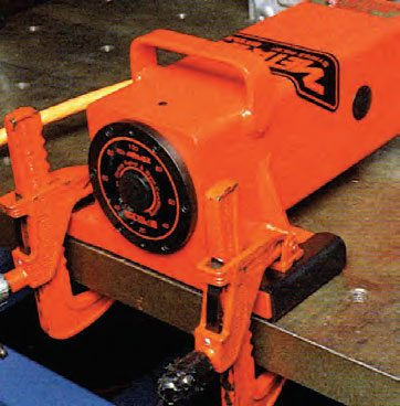 The force inducer generates the vibrations that are transmitted to the work piece. This inducer is clamped to a steel worktable upon which the parts are secured.