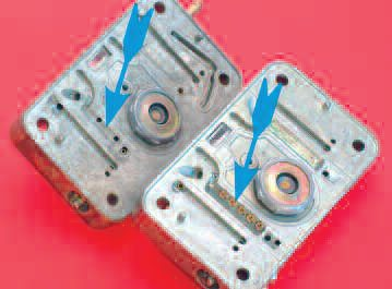 Here, indicated by the arrows, is what goes for an emulsion tube on a Holley carb. Most Holley carbs are used on a plenum-style intake, rather than an independent runner (IR) system. When induction pulses are smoothed, as is the case when all eight cylinders of a V-8 draw from a common source, we find the need for an emulsion tube and the degree to which it affects the mixture is decreased. In this photo, we see a typical emulsion-hole pattern for a typical street engine (left) and the adjustable jetted system (right) used for fine tuning the fuel curve on a serious high-performance engine sporting a race or race-like cam.