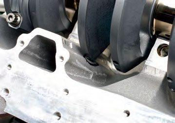 Here's an example of a stroker crank in a Honda race build. Notice where the counterweight hits the black wall. Remember: When inspecting for stroker crank clearance, rotate the crank slowly as you monitor clearances.