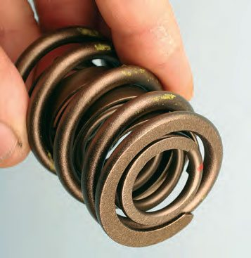 Typical dual-spring with dampener spring. The bottom of the retainer must fit snugly into the ID of the inner spring.