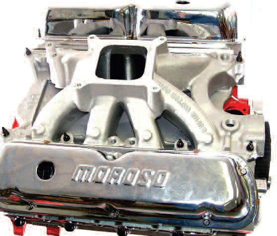 Here, the more direct routing of the runners of a single-plane V-8 intake manifold can clearly be seen. This, and the ability of each cylinder to utilize all four barrels of the carb, gives this style of manifold a clear top-end power advantage.