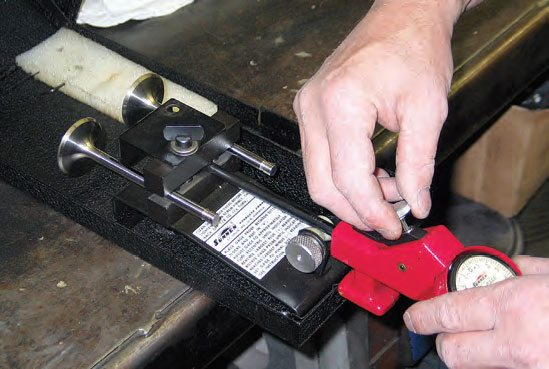 Prior to honing new valve guides, the guide ID gauge is adjusted for valve stem diameter plus specified oil clearance.
