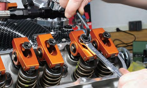 Initially tighten rocker arm adjustment to zero lash with the cam on its base circle.