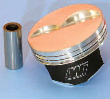 This Wiseco race piston carries many performance-enhancing features. These include high ring placement, thin ring sections, a shorter/stiffer/ lighter wrist pin, thermal-barrier coating on the crown, and anti-friction skirt coating.