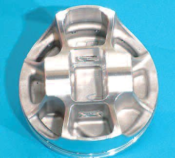In an effort to increase rigidity and strength while minimizing weight, a modern race piston employs a strutted and braced design such as seen here. Also note how close the pin bosses are to the center of the piston, allowing for a shorter pin to be used.