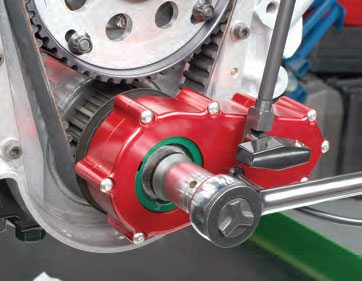 The crank position encoder slips onto the crank snout (using one of their crankspecific keyed aluminum adapters). The encoder is then secured to the block face to prevent encoder body rotation.